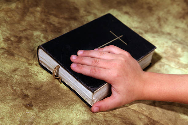 children's hand on bible. - young singles stock photos and pictures