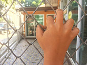 Children's hand with grille.