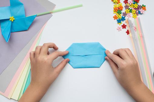children's hands do origami