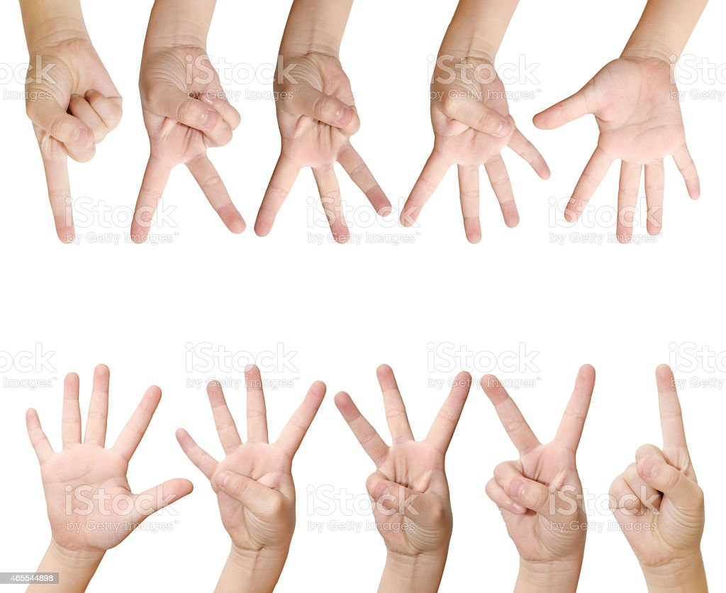 Children's hands holding up fingers on a white background stock photo