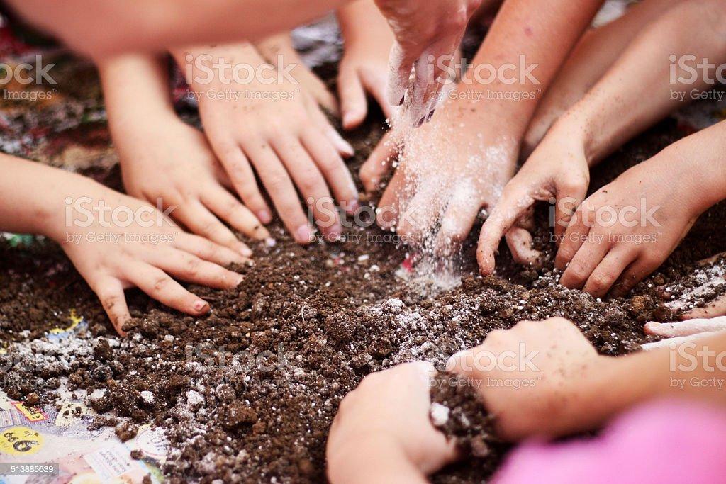 Children's hands in dirt stock photo