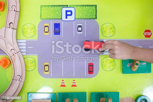 912120622 istock photo Children's hands playing wooden toy train 1040404882