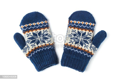 Children's woolen patterned knitted mittens isolated on white