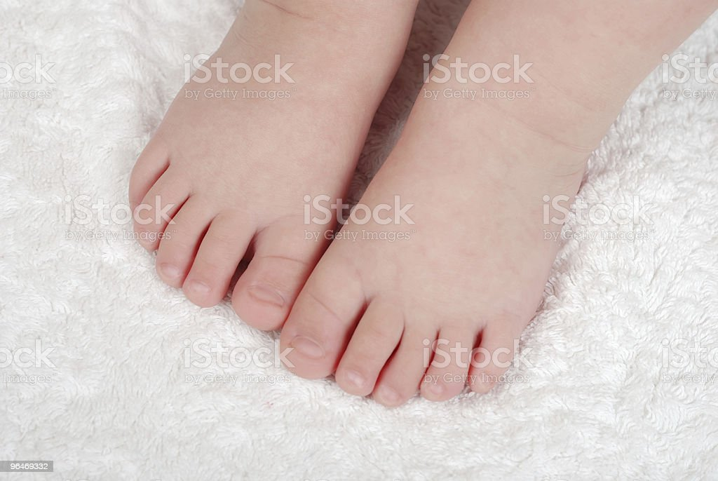 Children's legs on a soft towel royalty-free stock photo