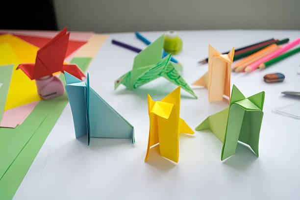 children's  origami  wolf's and bird's from colored paper. - origami anleitungen stock-fotos und bilder