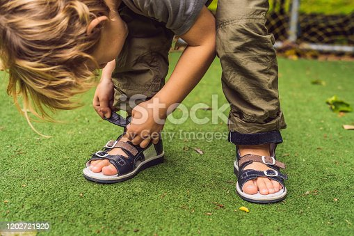 children's orthopedic shoes on the boy's feet.