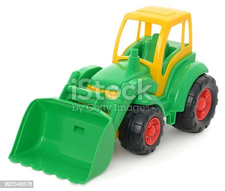 Children's plastic toy, yellow-green bulldozer isolated on white