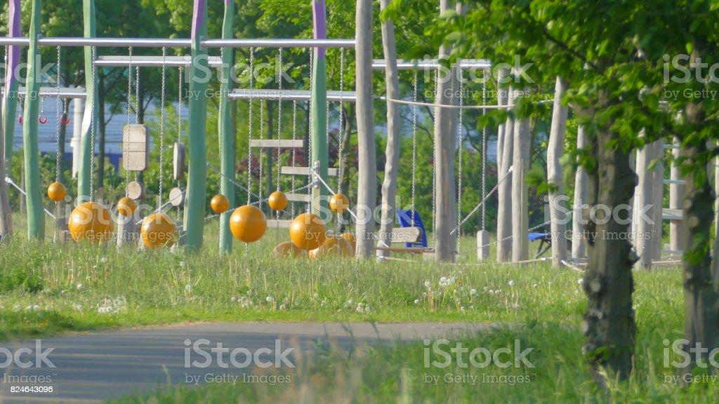 Children's playground in the park stock photo