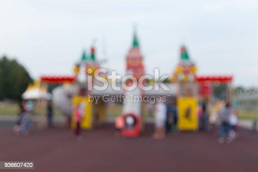 656743520 istock photo Children's playground in the summer evening in the park 936607420