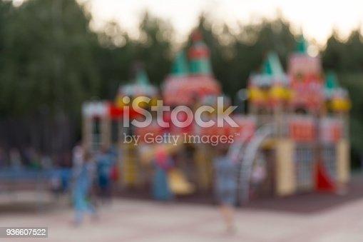 656743520 istock photo Children's playground in the summer evening in the park 936607522