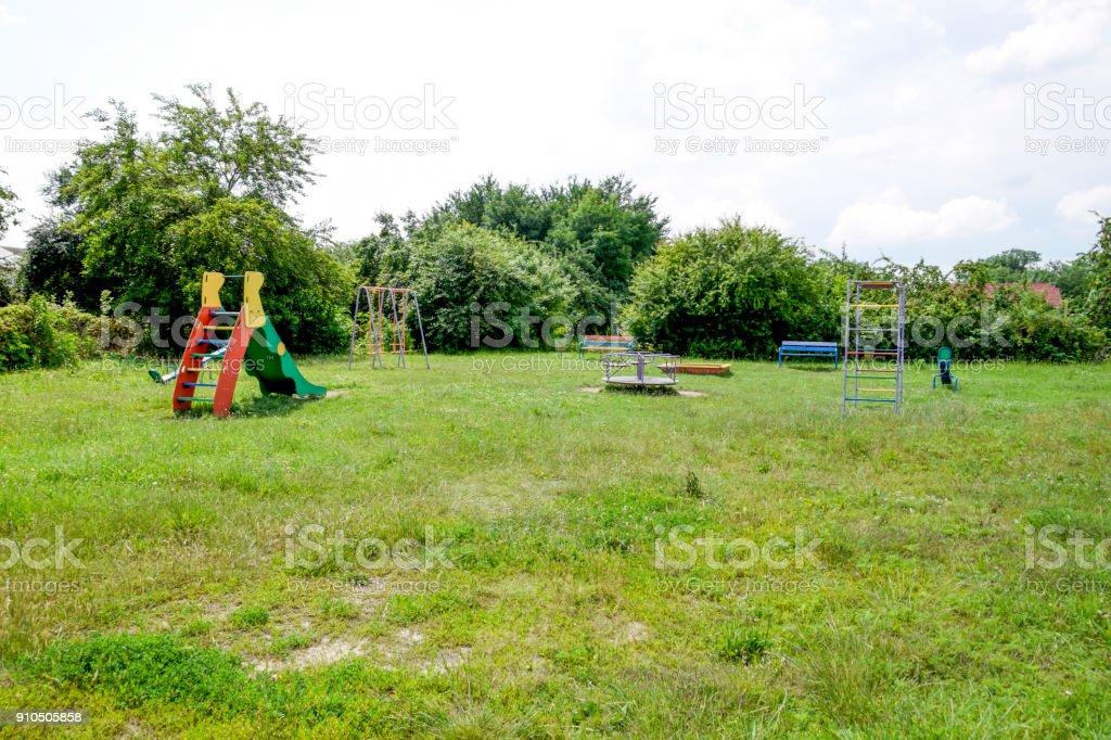 Children's playground. Swing, carousel and slide stock photo
