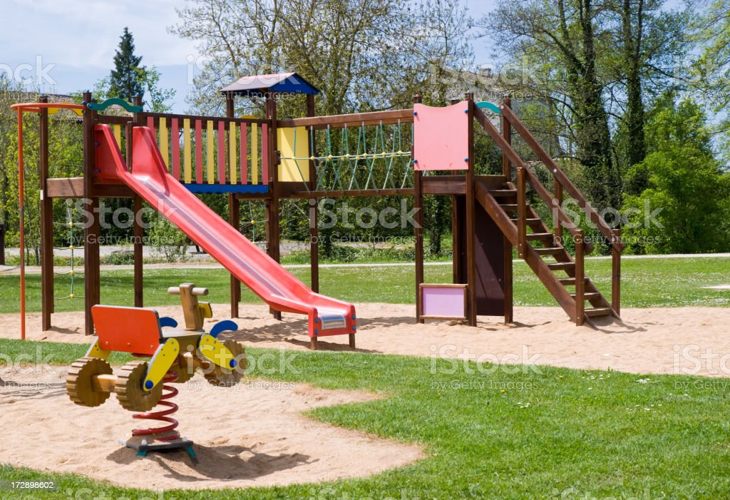 Children's playground with climbing frame and slide stock photo