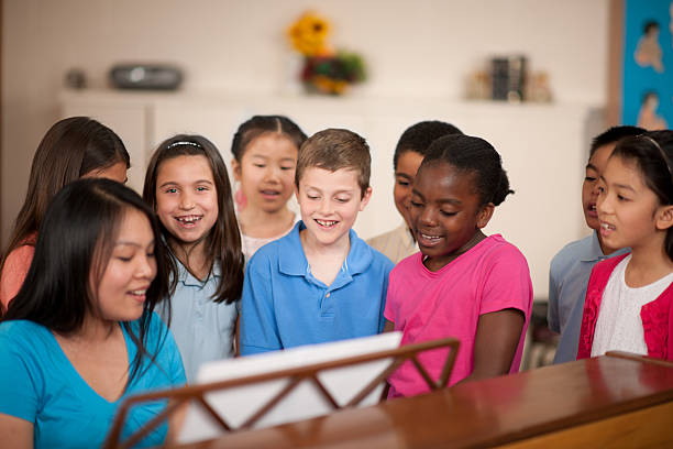 children's religious program - praise and worship stock photos and pictures