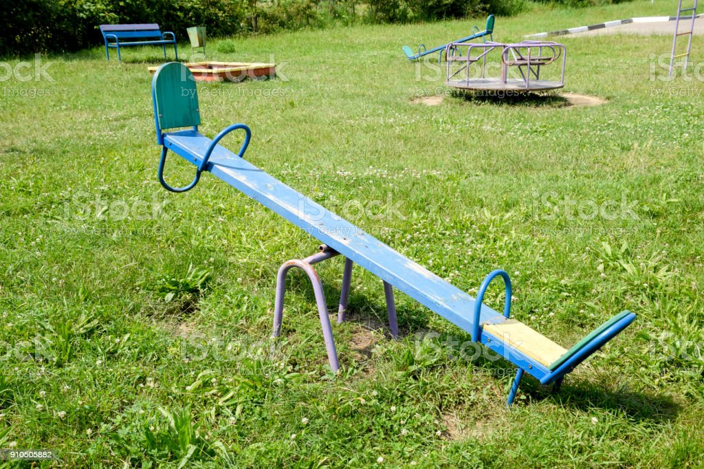 Children's rocking chair on the playground. stock photo