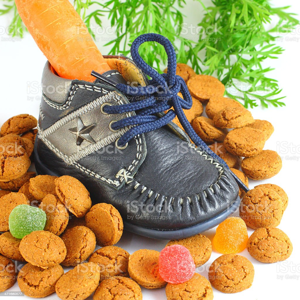 Childrens shoe with carrot voor Sinterklaas and pepernoten royalty-free stock photo