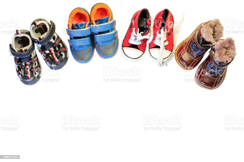 Children's shoes for different weather and time of year royalty-free stock photo