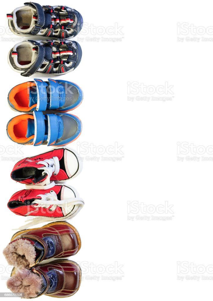 Children's shoes for different weather and time of year royalty free stockfoto