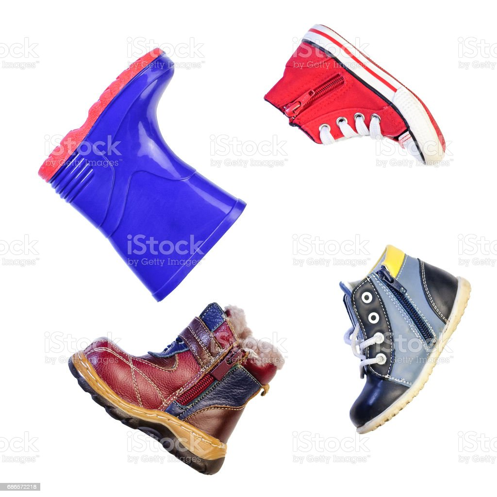 Children's shoes for different weather and time of year zbiór zdjęć royalty-free