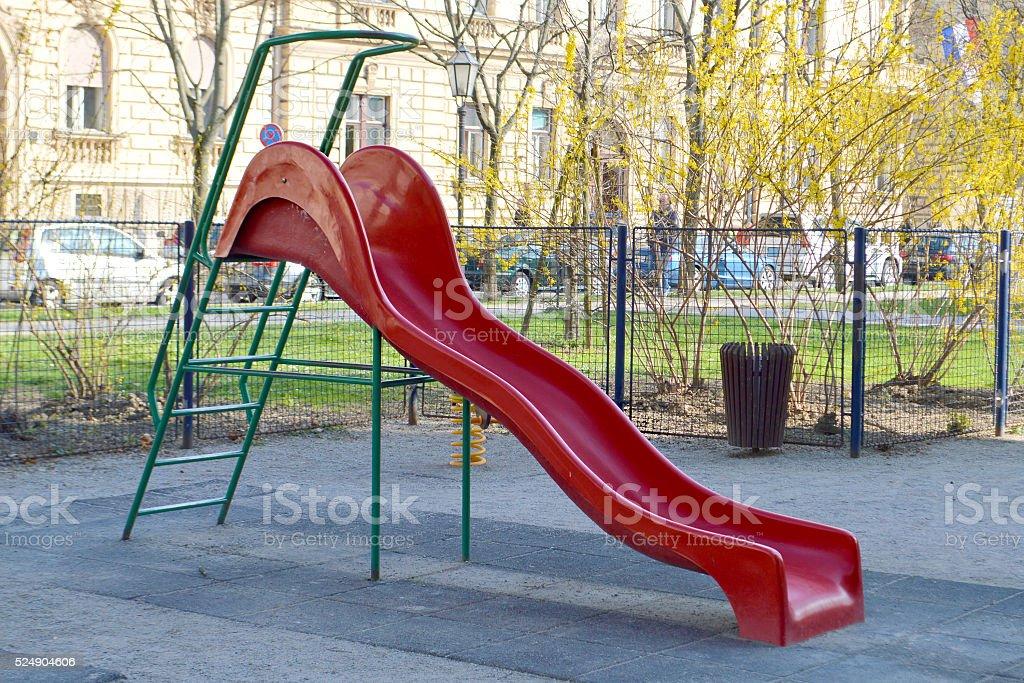 Children's slide at the playground stock photo