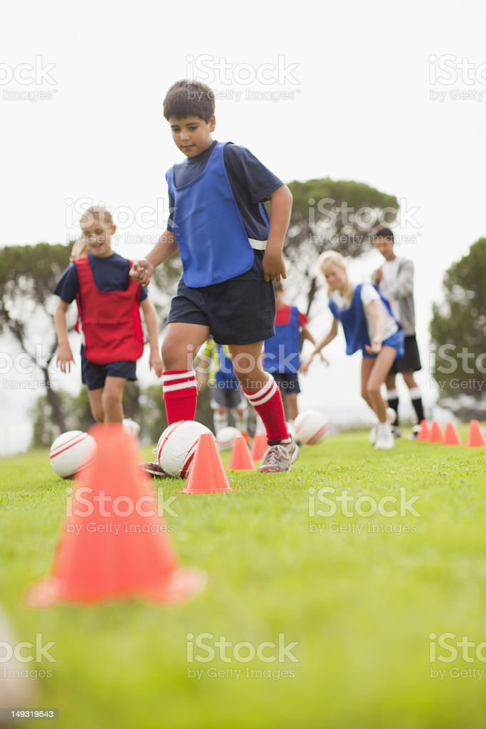 Childrens soccer team training on pitch stock photo
