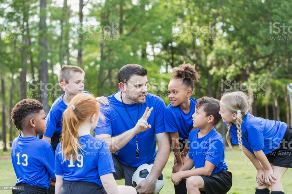 Children's soccer team with coach - foto stock