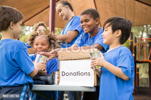 istock Children's sports team charity drive for donations, local disaster relief. 863105740