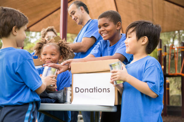 Children's sports team charity drive for donations, local disaster relief. stock photo