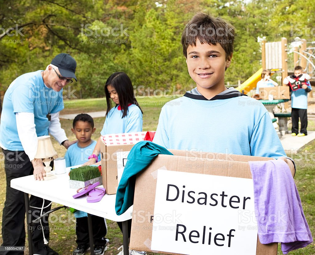 Children's sports team collecting donations for disaster relief victims. Volunteers. royalty-free stock photo