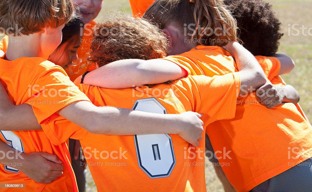 Children's sports team in huddle stock photo