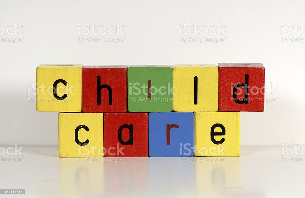 Children's toy blocks spelling out the words 'child care' royalty-free stock photo