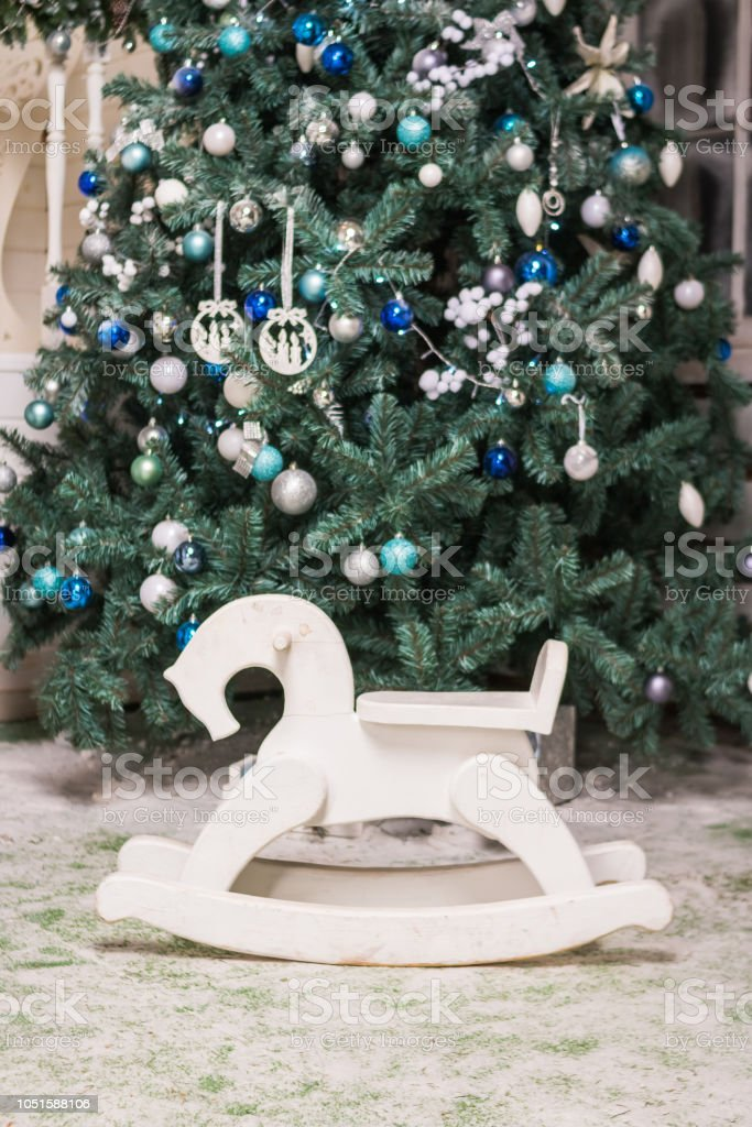 Remarkable Childrens Toy Rocking Horse Near Christmas Tree Gifts And Machost Co Dining Chair Design Ideas Machostcouk