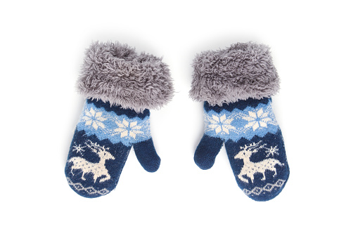 Baby winter knitted mittens with deer isolated on white background