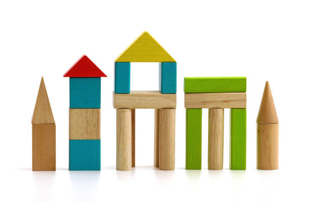 children's wooden blocks on white background - toy block stock pictures, royalty-free photos & images