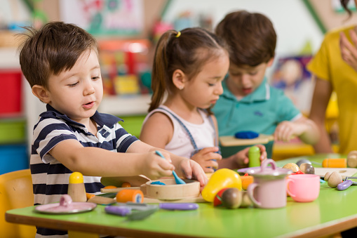 Childs Are Playing With Play Clay In Classroom Stock Photo - Download Image Now