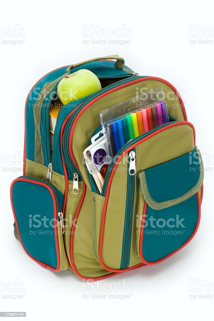 Child's backpack with school supplies and healthy snack stock photo