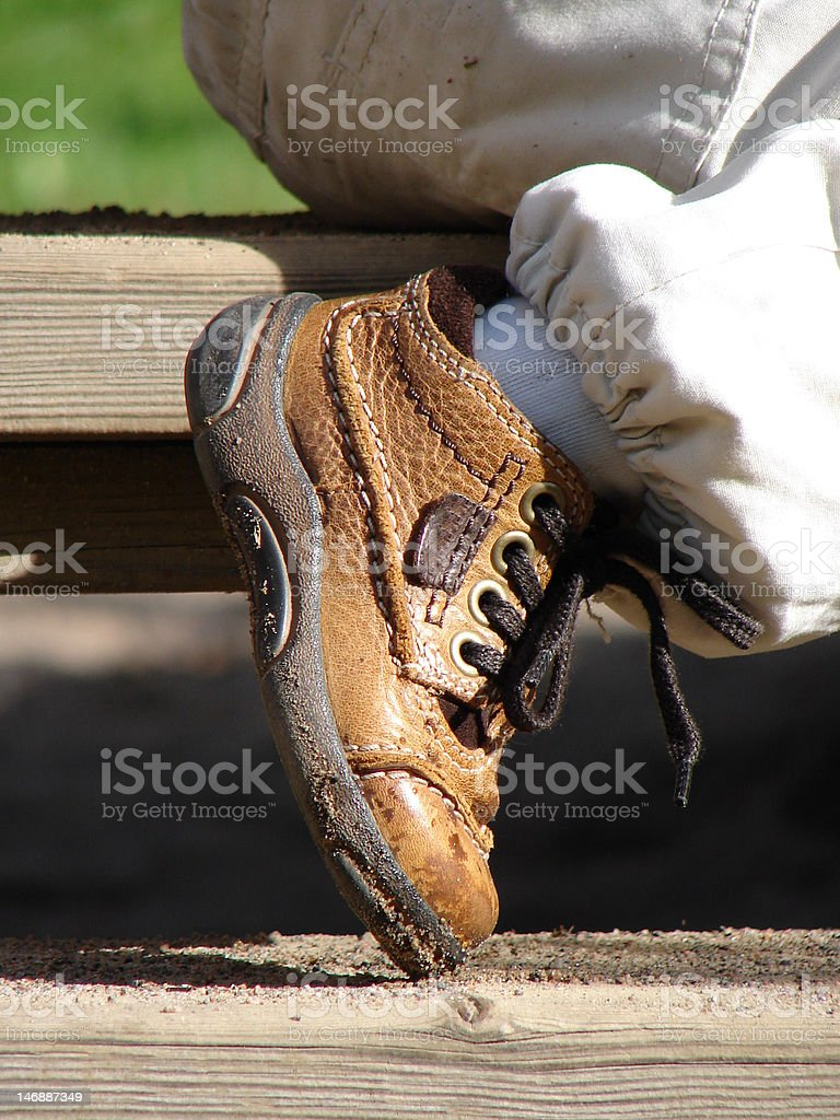 Child's brown boot royalty-free stock photo