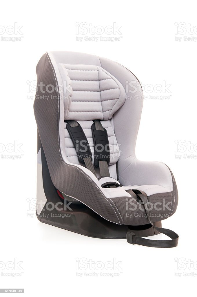 Child's carseat sitting against a white background royalty-free stock photo