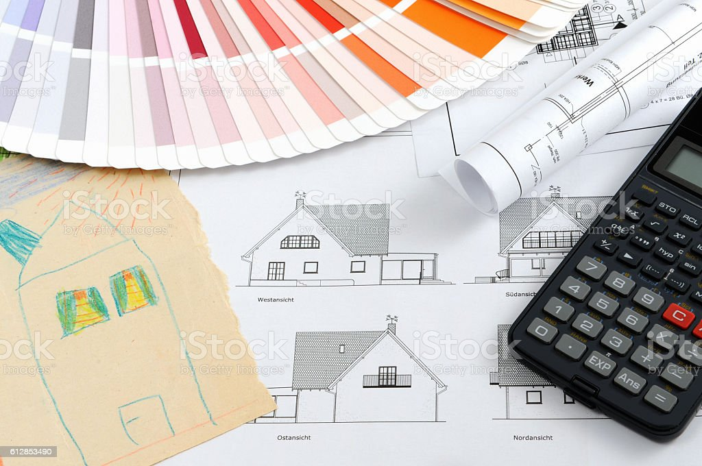 child's drawing of house with blueprints plan and calculator stock photo