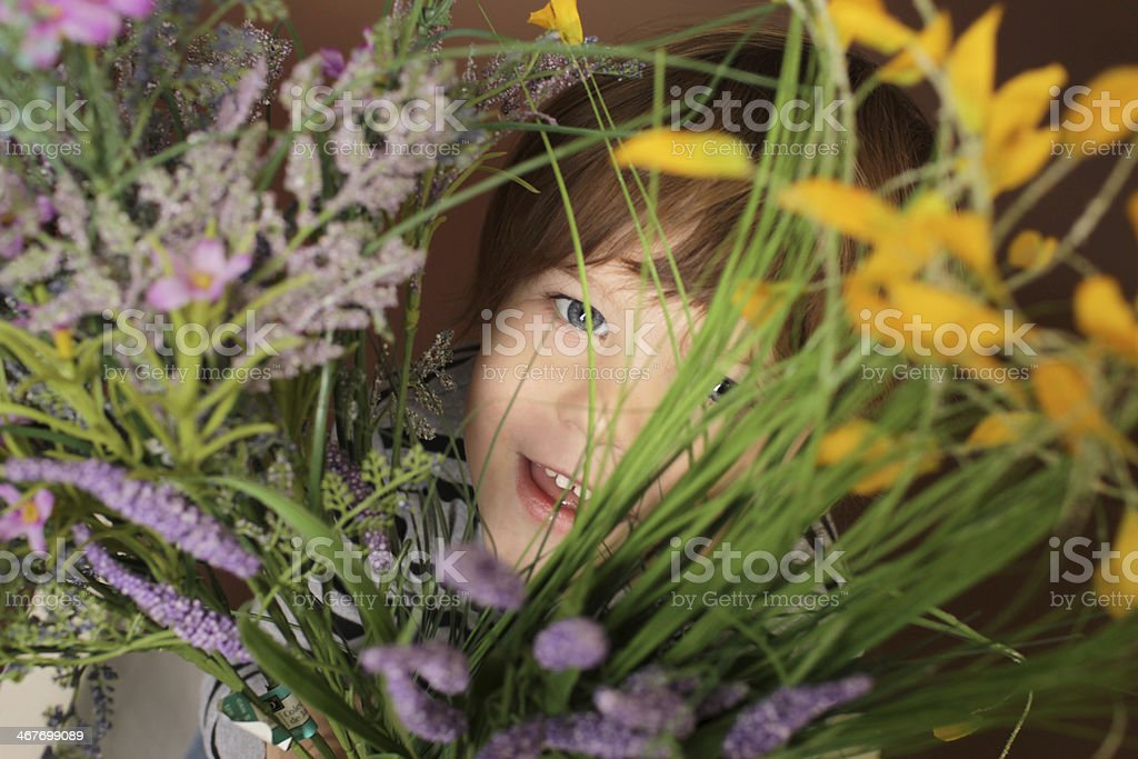 Child's Face with Valentine's Day Flowers stock photo