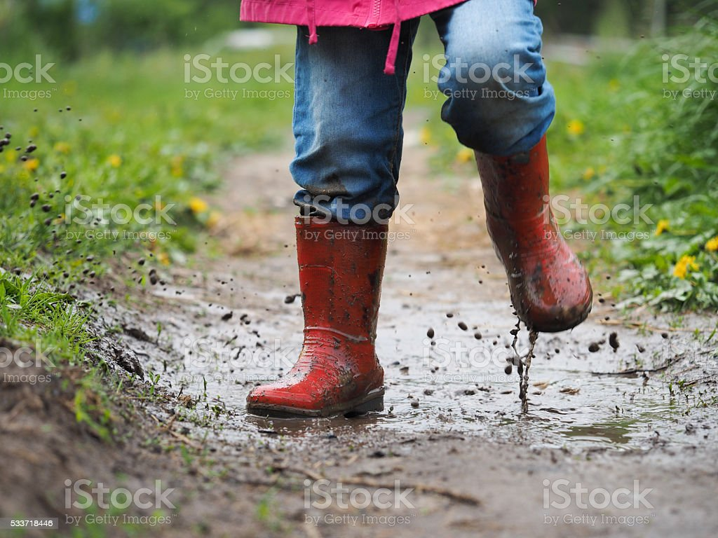child's feet in the muddy stock photo