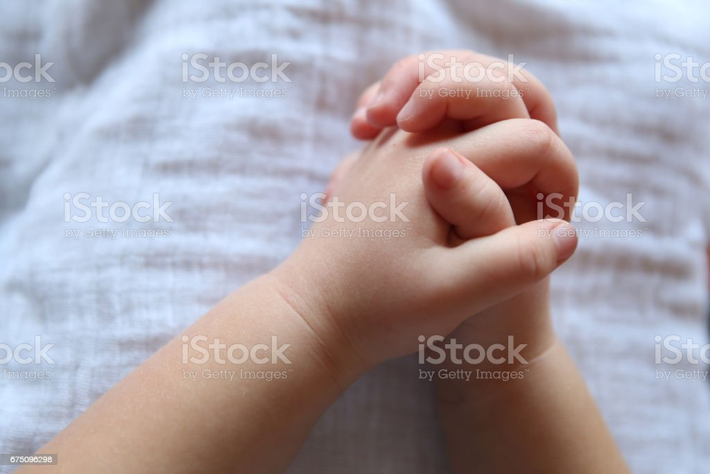 A Child's Folded Hands stock photo