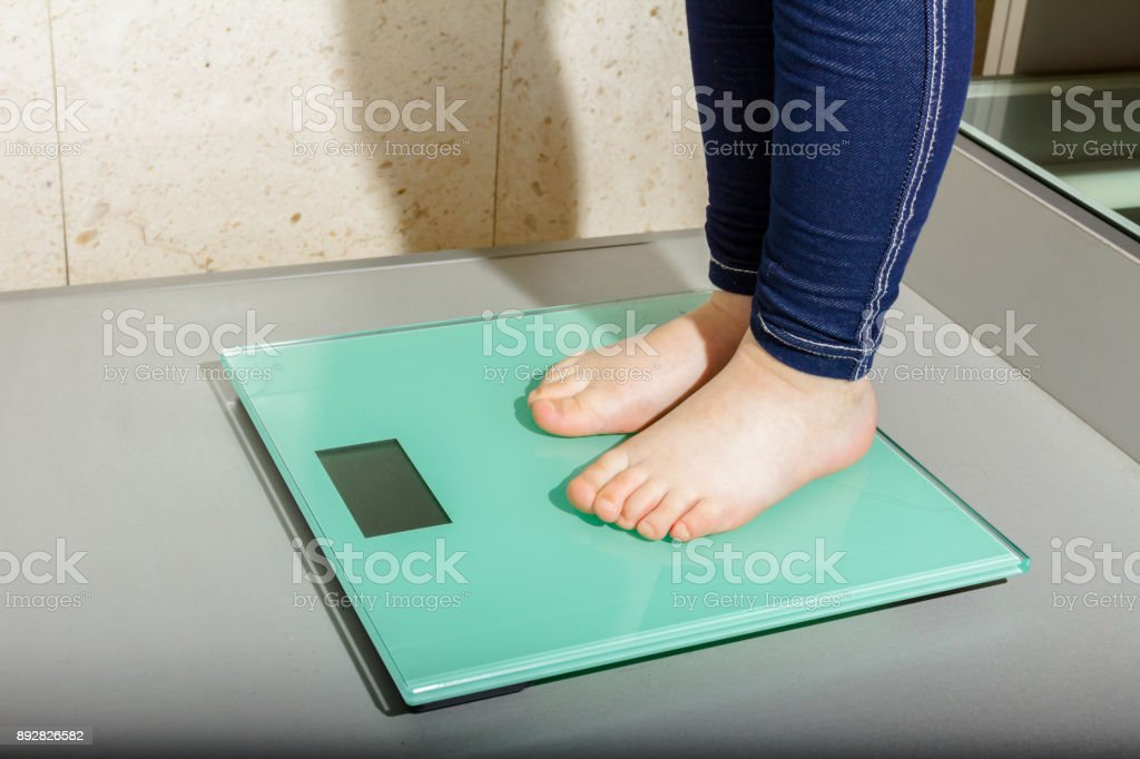 Child's foot on fashionable digital scale stock photo