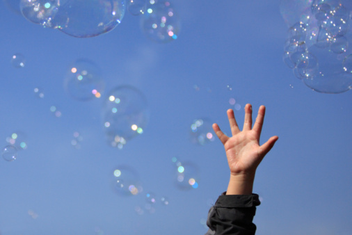 istock Child's Hand and Bubbles 92257840