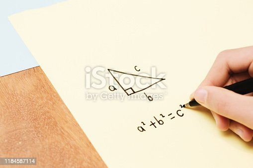 istock Child's hand doing geometry home  or class work 1184587114