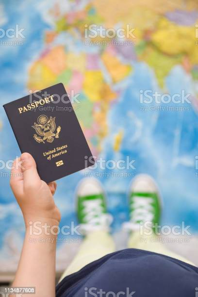 Childs hand holding us passport map background ready for traveling picture id1134877608?b=1&k=6&m=1134877608&s=612x612&h=ueyfniwuemjwl pyf4rtla928jzvkvbq8biqkoyp iq=