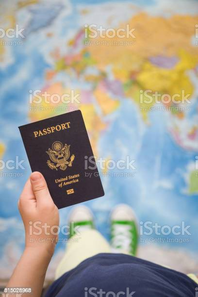 Childs hand holding us passport map background ready for traveling picture id815028968?b=1&k=6&m=815028968&s=612x612&h=oeoe5k4vjhksk7uzjjcxg3591gbs9wtit4mdkk2hxrg=