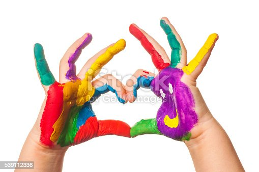 istock Child's hand painted watercolor in heart shape against white background 539112336