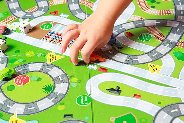 Child's Hand Playing A Board Game stock photo