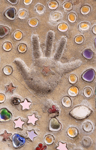 Child's Handprint in Clay With Mosaic stock photo