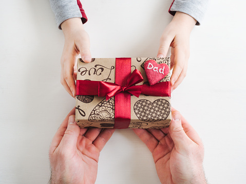 istock Child's hands and a beautiful gift box, 1142805542